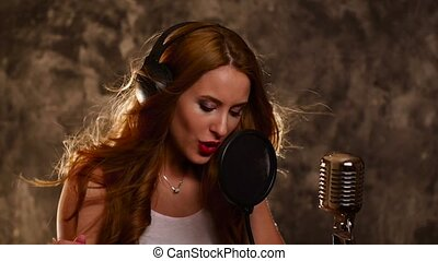 girl listening to music on headphones and singing, slow...