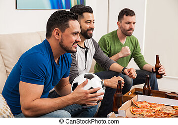 Male friends watching a soccer game