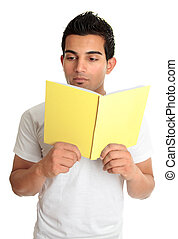 Man reading from a book - Man reads from a hardcover book,...