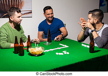 Men having fun during poker night - Portrait of a group of...
