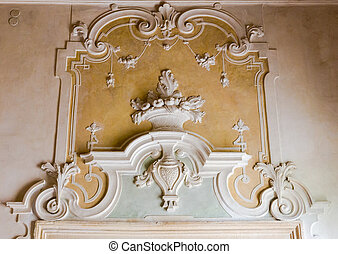 The ornament of a fireplace hood in a neo classical villa. -...