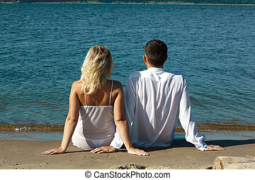 couple on the beach - backview of romantic slavonic couple -...