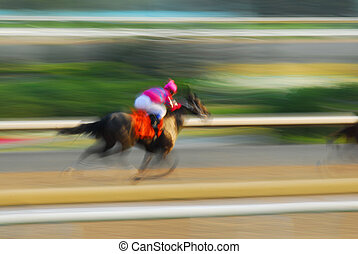 Horse racing - Jockey on a horse racing on race track