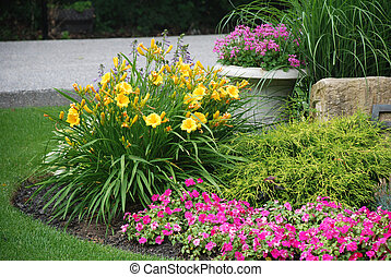 Landscaped flower garden - Landscaped garden with flowers...
