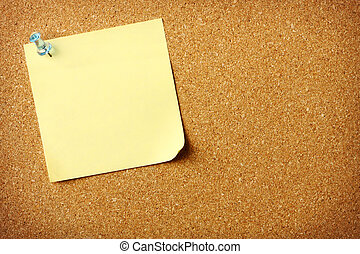 Blank Post It note on Corkboard - Blank sticky note pinned...