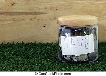 save money for investment concept money in the glass