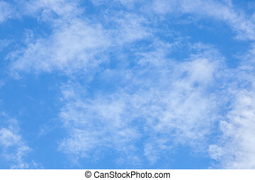 Blue sky background - white fluffy clouds in the blue sky