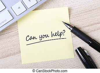 Can You Help - Top view of Can You Help sticky note pasted...