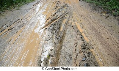Tire tracks - Tire tracks on a muddy road in the...