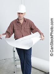 Contractor looking blueprints