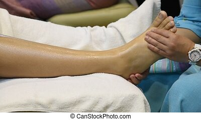Foot massage - Foot massage in the spa salon, foot spa...