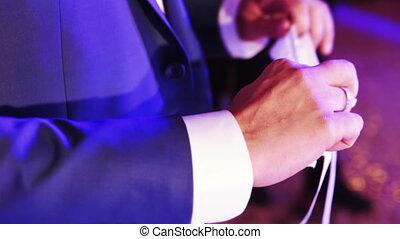 Garter in male hands - Groom is holding garter to throw