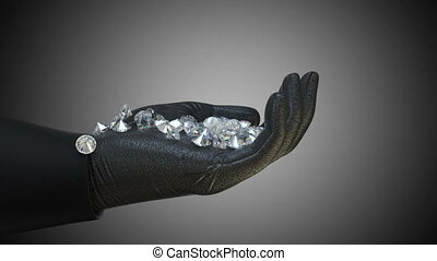 Sparkling diamonds and gems falling down in to gloved hand...