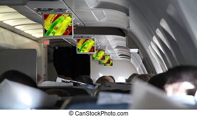 In the Cabin of Passenger Aircraft - Showing films and...