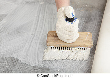 Hand with brush for gluing - Man\'s hand with brush during...