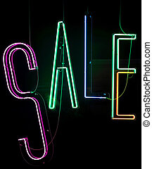 Sale - Neon Lights Sale Sign in Shop Window