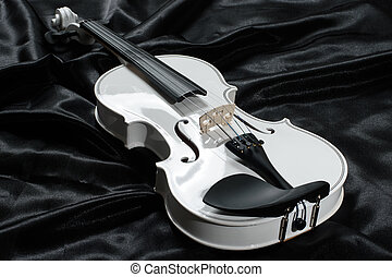 Photograph of a white violin - Closeup of a white violin on...