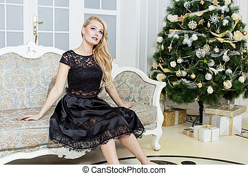 mature middle age woman in rich interior decorated for...