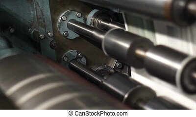 Industrial Offset Press Rollers - Handheld closeup shot of...