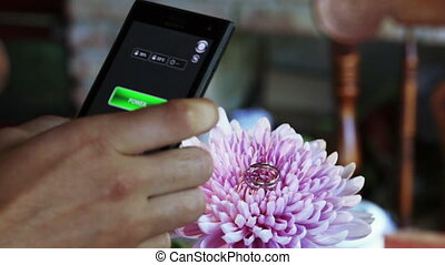 Wedding rings on flowers - At wedding phone and camera...