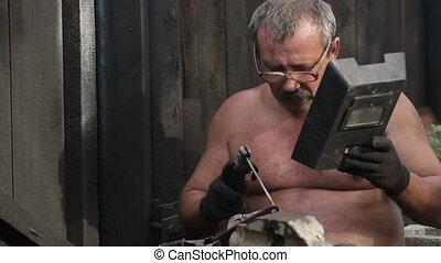 Rural Man is Welding