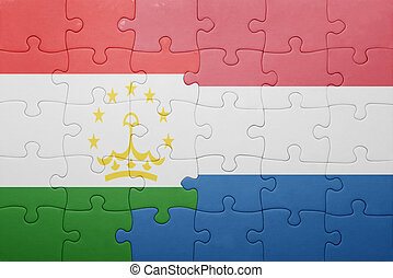 puzzle with the national flag of netherlands and tajikistan...