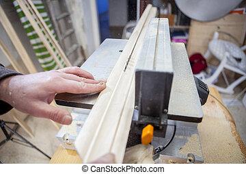 Carpenter using electric circular saw - Carpenter working...