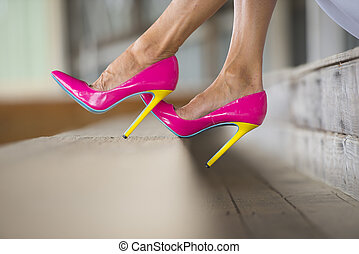 Female Legs and high heels sitting relaxed