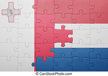 puzzle with the national flag of netherlands and malta