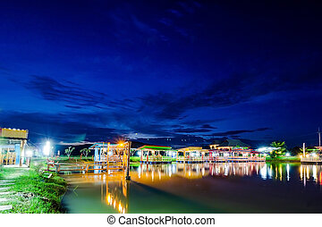 Colorful houseboat village on Lake in Chiangrai, Thailand