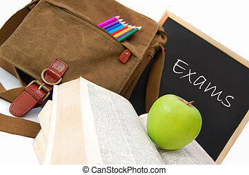 Exams - Satchel and books next to a blackboard with the word...