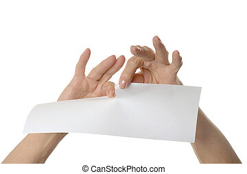 Hands tearing paper sheet, closeup on white background