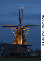 Authentic renovated windmill with Christmas star - Authentic...