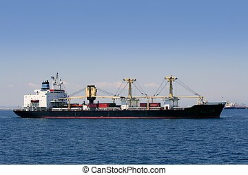 Cargo container freighter ship sailing in Mediterranean sea
