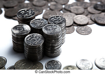money in the form of coins on a white close up
