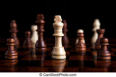 chess game with the king in the center - chess pieces with...