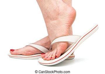 foot in sandal on white background - female foot in sandal...