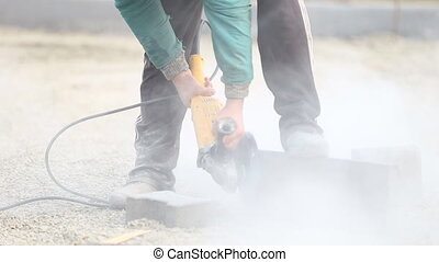 cutting paving slabs - cutting of concrete paving slabs...
