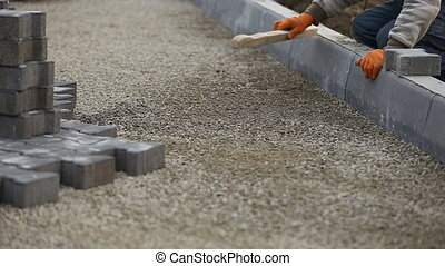 leveling gravel a wooden board closeup