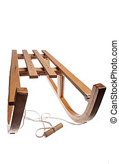 Wooden sledge - Color picture of a wooden sledge isolated on...