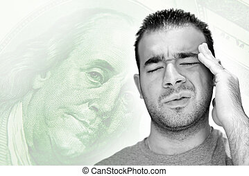 Stressful Economy - A young man holds his head in anguish as...