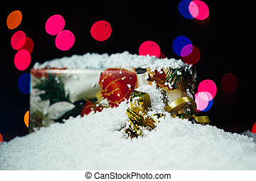 snow and christmas gift on a bokeh background - snow and...