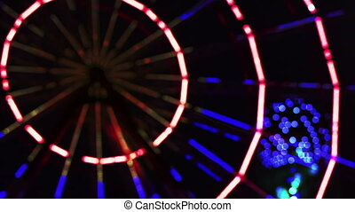 Ferris wheel night in defocusing