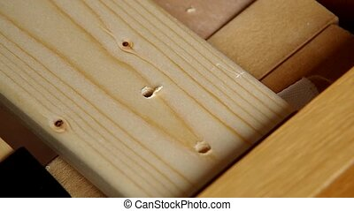 Screw being screwed into a wood - Use screw machine for...