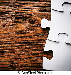 Placing missing a piece of puzzle business concept wooden...