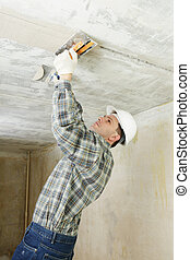 Plastering - Contractor plastering the ceiling