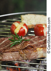 steak on the grill with tomato
