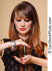 orient girl with makeup open palm