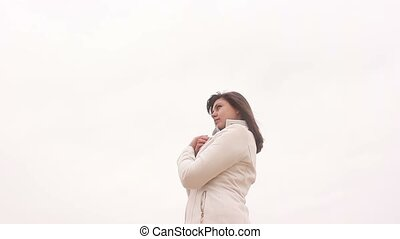 woman portrait girl in coat on white background autumn wind...