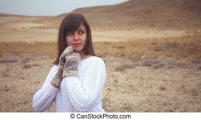 girl woman in a sweater and mittens on the nature autumn...